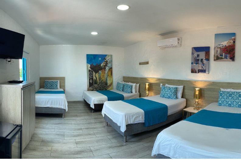 Habitaciones hotel aldea plaza doradal for Habitacion quintuple